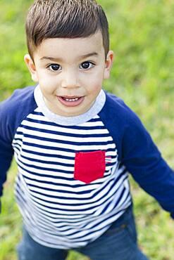 Close up of Hispanic boy outdoors