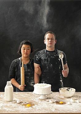 Messy couple baking cake