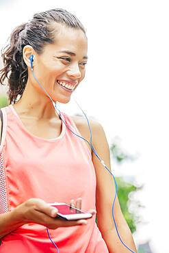 Indian athlete listening to mp3 player