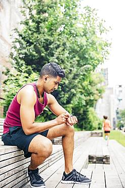 Indian athlete timing himself in city