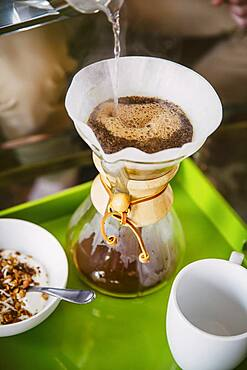 Caucasian man pouring breakfast coffee