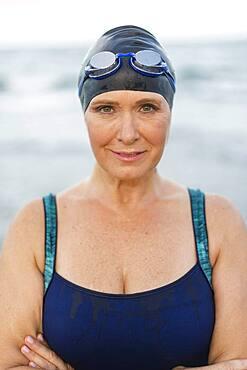 Caucasian swimmer on beach