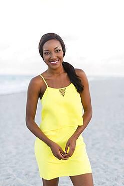 Black woman smiling on beach