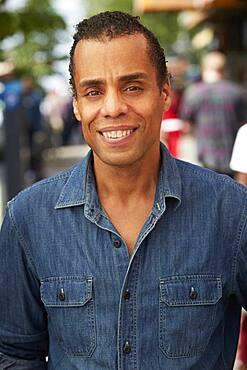 Mixed race man smiling