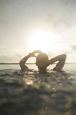 Caucasian woman swimming in still lake