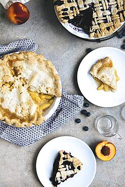 Plates of peach and blueberry pies