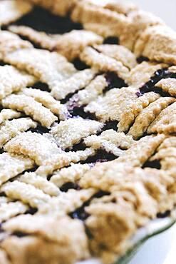 Close up of blueberry pie with lattice crust
