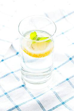 Close up of glass of herbal lemon water
