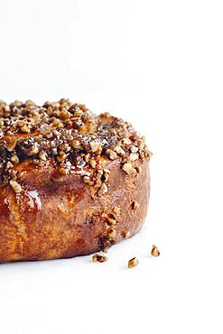 Close up of cinnamon roll with nuts