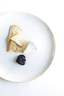 Plate of brie cheese, jam and crackers