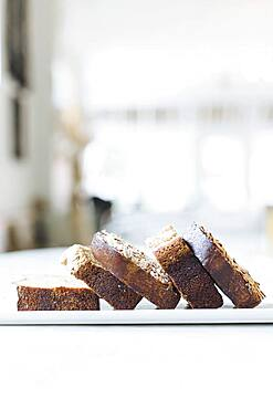 Close up of sliced coffee cake on cafe counter