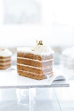 Close up of platter of cake on cafe counter