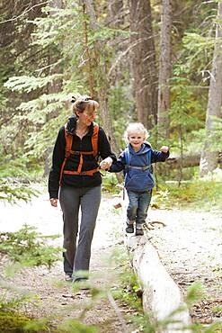 Caucasian mother and son hiking in forest