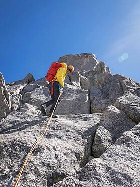Caucasian climber on mountainside