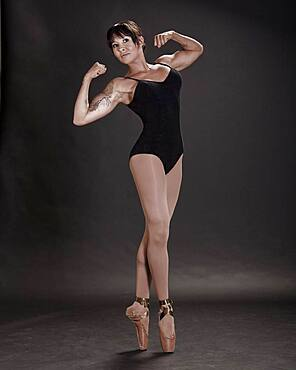 Hispanic ballet dancer flexing muscles