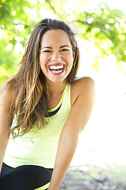 Mixed race woman laughing outdoors