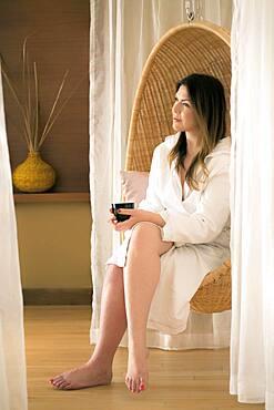 Caucasian woman sitting in spa chair