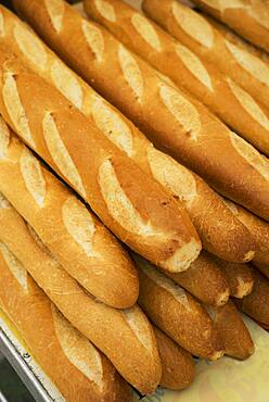 Close up of pile of baguettes