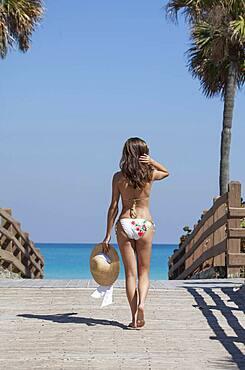 Caucasian woman wearing bikini outdoors