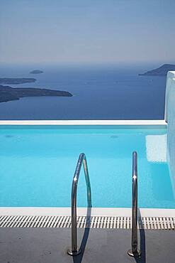 Swimming pool on hilltop over ocean