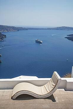 Lawn chair on hilltop overlooking ocean