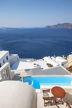Rooftop swimming pool over Santorini bay, Cyclades, Greece