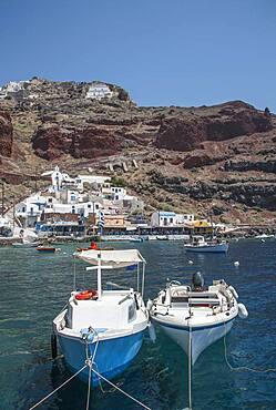 Boats in Santorini bay, Cyclades, Greece