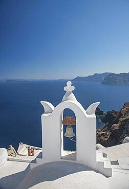 Church bell on hillside over seascape