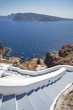High angle view of hillside steps over ocean