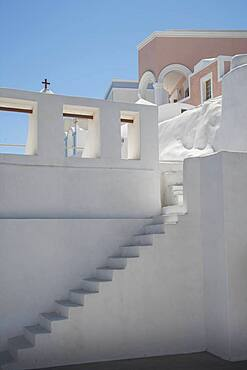 Steps on building wall under blue sky