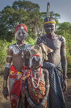 Black father and teenage children in traditional clothing