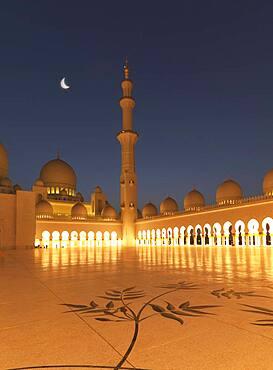 Illuminated colonnade, domes and tower at night
