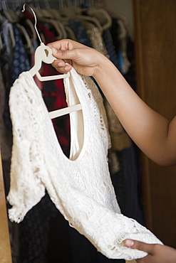 African American woman examining sweater