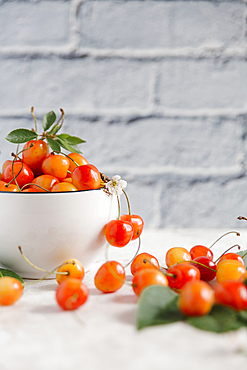 Cherries on white wooden table