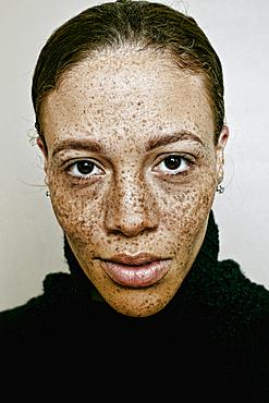 Close up of serious mixed race woman