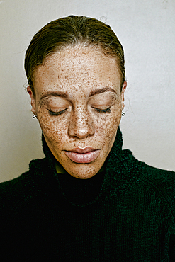 Close up of mixed race woman with eyes closed