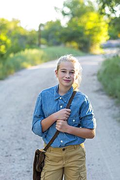 Portrait of confidence Caucasian girl hiking