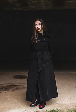 Portrait of serious Caucasian woman wearing black coat