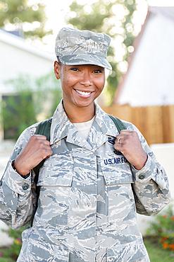 Portrait of smiling black woman soldier