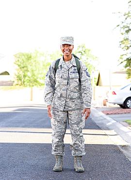 Portrait of black woman soldier standing in street