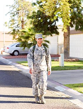 Black woman soldier walking in street