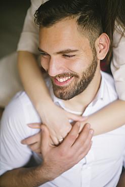 Caucasian woman hugging smiling man