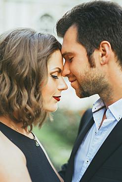 Portrait of smiling Caucasian couple touching faces