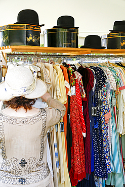 Woman shopping for dress in store