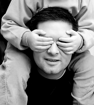Son covering eyes of father