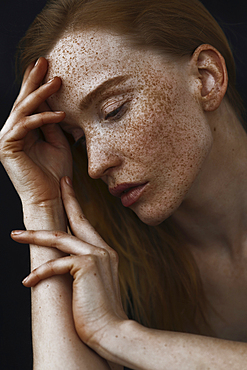 Close up of pensive Caucasian woman with freckles