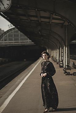 Caucasian woman waiting at train station