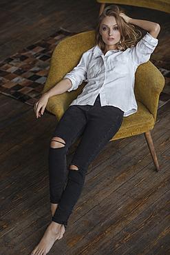 Portrait of Caucasian woman sitting in armchair