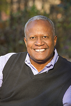 Portrait of African American man smiling outdoors