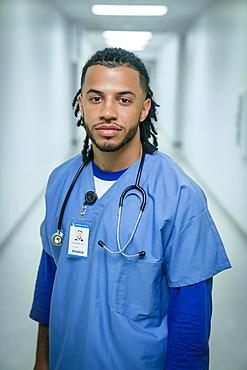 Portrait of serious mixed race nurse